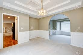 empty luxury home interior with beige carpet of dining and living
