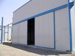 porte per capannoni metalcam service produzione installazione assistenza e