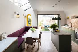 home renovation adds bright colors and scale like shingles curbed a richer palette of materials glazed herringbone tile fabric banquettes plywood fingerpulls and marble handrail ends elevate the lower floors
