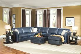 navy blue leather sectional sofa above white rug also twin table