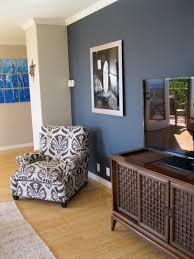 Which Wall Should Be The Accent Wall by Shade Of Blue On Wall Camoflauges Tv Love The Chair Too Home