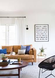 sara s living room reveal emily henderson emily henderson sara moto neutral cozy masculine living room 3