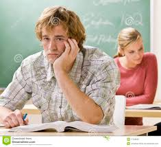 Student At Desk by Bored Student At Desk In Classroom Royalty Free Stock Images