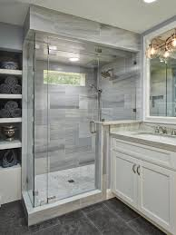 bathroom with glass and marble shower gray limestone floors and a mix of stone marble and tiles create a rich and elegant master bathroom the shower is lena white marble with a floor of small circular tiles