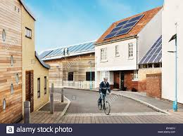 eco friendly homes man cycling sustainable eco friendly houses eco town england uk