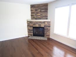 upgrade old corner gas fireplace with stone posted by trina