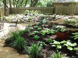 backyard landscape water feature hostas containers with
