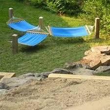 diy hammock posts dig 2 holes 3 ft deep and 14 feet apart we