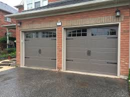 Pictures Of Garage Doors With Decorative Hardware 8x7 Clopay Steel Insulated Bronze Carriage Doors With True Arch