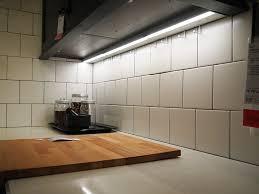 contemporary kitchen with black wood kitchen cabinet slim fluorescent strip fixture under cabinet lighting