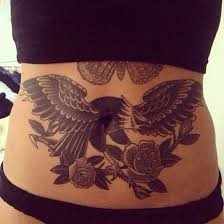 tattoo eagle girl black ink traditional eagle with roses tattoo on girl stomach