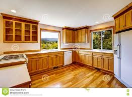 White Kitchen Cabinets White Appliances by Light Brown Kitchen Cabinets White Appliances And Hardwood Floor