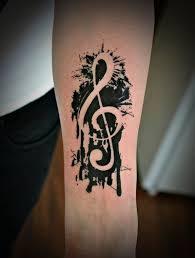 black music violin key tattoo on forearm