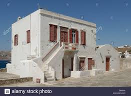 mykonos cyclades grecce white washed two storey house with brown