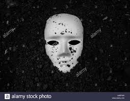 background halloween image white mask in soil horror background for halloween concept and