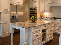 granite countertop brown and white kitchen cabinets refrigerated