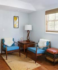 framed art living room midcentury with area rug wallpaper and wall