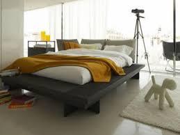 King Size Platform Bed With Black Vinyl Upholstery Bedroom