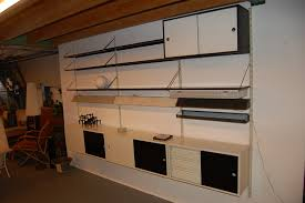 modular wall unit with shelves and cabinets tjerk reijenga