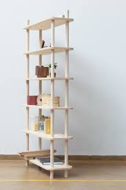Modular Bookcase Systems Modular Shelving System On Wooden Rods Digsdigs