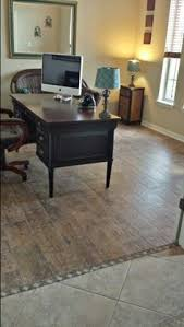 Laminate Flooring In Kitchen by Light Tile With A Seamless Transition To Dark Wood Floor Perfect