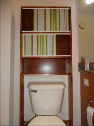 space saving bathroom decor ideas with teak wood open shelving