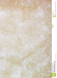 beige wall painted with textured paint roller stock photo image