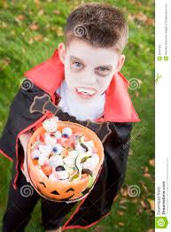 young boy wearing vampire costume on halloween royalty free stock