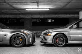 white nissan 350z nissan 350z z33 vs mitsubishi lancer evolution 9 mr kiseki studio