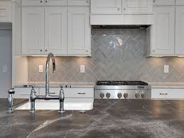 Kitchen Tile Backsplash White Raised Panel Kitchen Cabinets With Gray Geometric Tile