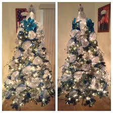 white deco mesh tree with blue ribbon decorated with silver and