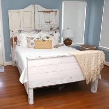 reclaimed waco custom wood bed frame with carved door headboard