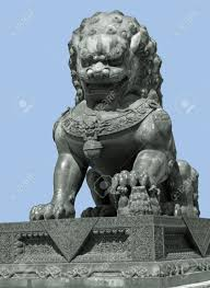 foo lion statue metallic sculpture of a lion stock photo picture and