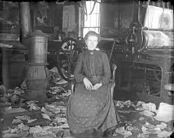 working class woman in shoe factory dressed for comfort and