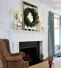 mantel decor with candelabra and vase and mirror with wreath