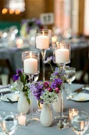 bud vase and tall candle centerpiece floral designs
