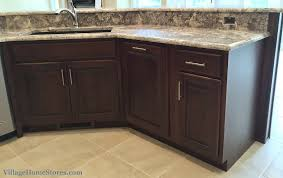 ganache granite archives village home stores shown below this taller backsplash height blends seamlessly with the space between the sink counter and the bar height counter on the angled peninsula