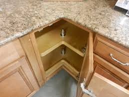 wood countertops kitchen cabinets with drawers lighting flooring