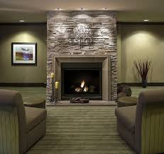 modern stone fireplace design in living room interior with leather