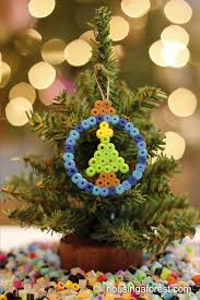 perler bead ornaments housing a forest