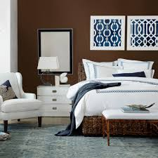 jonathan adler bedding bedroom transitional with dark wood floor