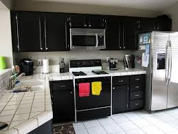Black Kitchen Wall Cabinets Black Kitchen Cabinet Design With White Laminated Countertop And