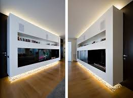 white bookcase fireplace and tv rack at modern apartment interior
