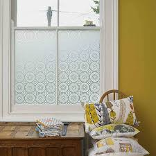 decorating chic white framed window with artscape window film