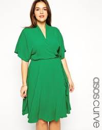 we love the emerald hue of this long green plus size dress and the