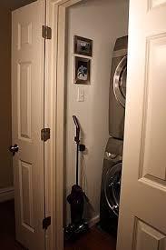 hallway laundry closet and ironing center