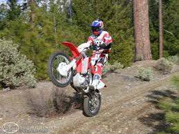how to wheelie a motocross bike 2005 wr450f vs crf450x photos motorcycle usa