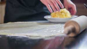 the process of making cakes in a cafeteria stock footage video