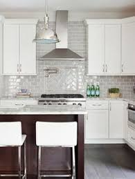 smoke glass subway tile white shaker cabinets shaker cabinets