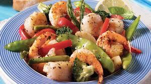 cuisiner des crevettes sauté de pétoncles crevettes aux légumes au gingembre et citron